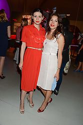 Left to right, NEFER SUVIO and LAUREN KEMP at the opening of Club To Catwalk: London Fashion In The 1980's an exhibition at The V&A Museum, London on 8th July 2013.