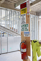 Central Connecticut State University. New Academic Building.  Project No: BI-RC-324 Contractor: Gilbane Building Company, Glastonbury, CT. Date of Photograph: 19 June 2012 Image No. 60 Camera View: Fire Extinguisher and Exit Position with Signs to benifit workers on site.