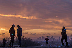 © Licensed to London News Pictures.19/02/2021. London, UK. Members of the public exercise during sunrise at Hampstead Heath, North London while the third national lockdown continues. Photo credit: Marcin Nowak/LNP