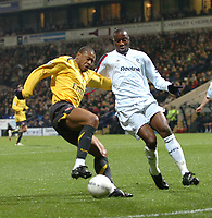 Photo: Paul Greenwood.<br />Bolton Wanderers v Arsenal. The FA Cup. 14/02/2007. Arsenal's Julio Baptista, left, shields the ball from the challenge of Bolton's Abdoulaye Meite