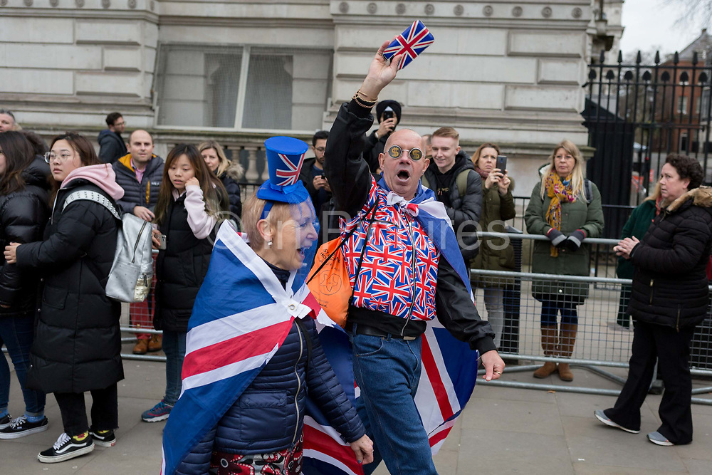 After threee and a half years of political upheavel in the British parliament, Brexiteers pass tourists at Downing Street as others celebrate in Westminster on Brexit Day, the day when the UK legally leaves the European Union, on 31st January 2020, in London, England.