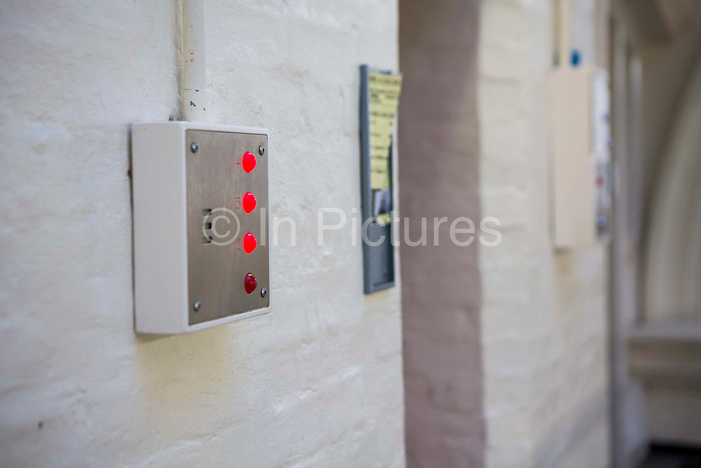 The cell emergency buzzer system flashing red after being activated from inside a cell on Benbow wing inside HMP/YOI Portland, a resettlement prison with a capacity for 530 prisoners. Dorset, United Kingdom.