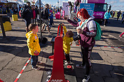 Brothers Colton and Camden play a yard game with mother Chelsea Alford at the AARP Block Party at the Albuquerque International Balloon Fiesta in Albuquerque New Mexico USA on Oct. 8th, 2018.