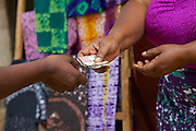 Asia Diwala serving a customer.<br /> <br /> Asia owns and runs a Batik business in KwaMatias, Tanzania.<br /> <br /> She attended MKUBWA enterprise training run by the Tanzania Gatsby Trust in partnership with The Cherie Blair Foundation for Women.