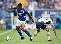 Leicester City's Liam Moore (L) in action during todays match  <br /> <br /> (Photo by Jack Phillips/CameraSport)<br /> <br /> Football - The Football League Sky Bet Championship - Leicester City v Leeds United - Sunday 11th August 2013 - King Power Stadium - Leicester<br /> <br /> © CameraSport - 43 Linden Ave. Countesthorpe. Leicester. England. LE8 5PG - Tel: +44 (0) 116 277 4147 - admin@camerasport.com - www.camerasport.com