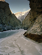 A narrow canyon. Trekking with yak herder Mohammad and Malang up the frozen Wakhan River, the only way up to the Little Pamir mountains, the extreme North-East of Afghanistan.<br /> Winter expedition through the Wakhan Corridor and into the Afghan Pamir mountains, to document the life of the Afghan Kyrgyz tribe. January/February 2008. Afghanistan