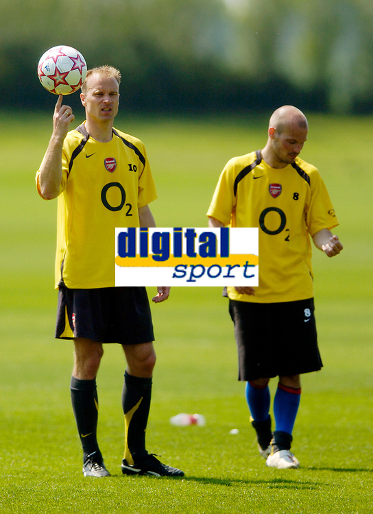 Photo: Richard Lane.<br />Arsenal Training Session. The Barclays Premiership. 11/05/2006.<br />Dennis Bergkamp shows Freddie Ljungberg how to spin the ball on his finger during training.
