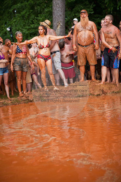Mud pit belly flop contest during the annual Summer Redneck Games Dublin, GA.