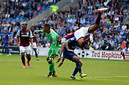 Ahmed Elmohamady of Aston Villa (27) takes a knock as he collides with Cardiff city goalkeeper Neil Etheridge and Cardiff's Joe Bennett.  EFL Skybet championship match, Cardiff city v Aston Villa at the Cardiff City Stadium in Cardiff, South Wales on Saturday 12th August 2017.<br /> pic by Andrew Orchard, Andrew Orchard sports photography.