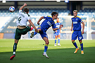 AFC Wimbledon midfielder Ethan Chislett (11) battles for possession with Plymouth Argyle defender Will Aimson (4) during the EFL Sky Bet League 1 match between AFC Wimbledon and Plymouth Argyle at the Kiyan Prince Foundation Stadium, London, England on 19 September 2020.