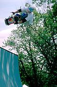 Skateboarder age 15 on half-pipe at Aquatennial Festival event.  Minneapolis Minnesota USA