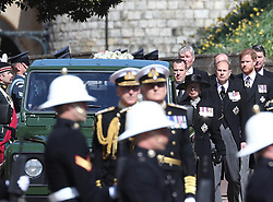 Members of the Royal family, Peter Phillips, the Princess Royal, the Earl of Wessex, the Duke of Sussex and Vice Admiral Sir Timothy Laurence, walk behind the coffin of the Duke of Edinburgh, at Windsor Castle, Berkshire. Picture date: Saturday April 17, 2021.