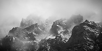 Storm clouds clearing over a mountain ridge in Los Glaciares National Park, Argentina (black and white)
