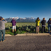 Teten Science Schools tour participants watch a herd of elk forage in the early morning hours. (Greg Peck, Matthew Bart, Sean Baker, Maura Bushior, Katie-Cloe Stock, Tracy Logan, Paul Maddex) Tetons in the background.