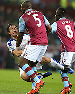 Shinji Okazaki of Leicester city falls between Jores Okore (5) and Idrissa Gana of Aston Villa .Barclays Premier league match, Aston Villa v Leicester city at Villa Park in Birmingham, The Midlands on Saturday 16th January 2016.<br /> pic by Andrew Orchard, Andrew Orchard sports photography.