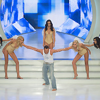 Zoltan Adok performs with contestants of The Queen live TV show hosts the three beauty contests Miss World Hungary, Miss Universe Hungary and Miss Earth Hungary, held in RTL Klub television headquarter Media Center Campona, Budapest, Hungary. Thursday, 13. May 2010. ATTILA VOLGYI