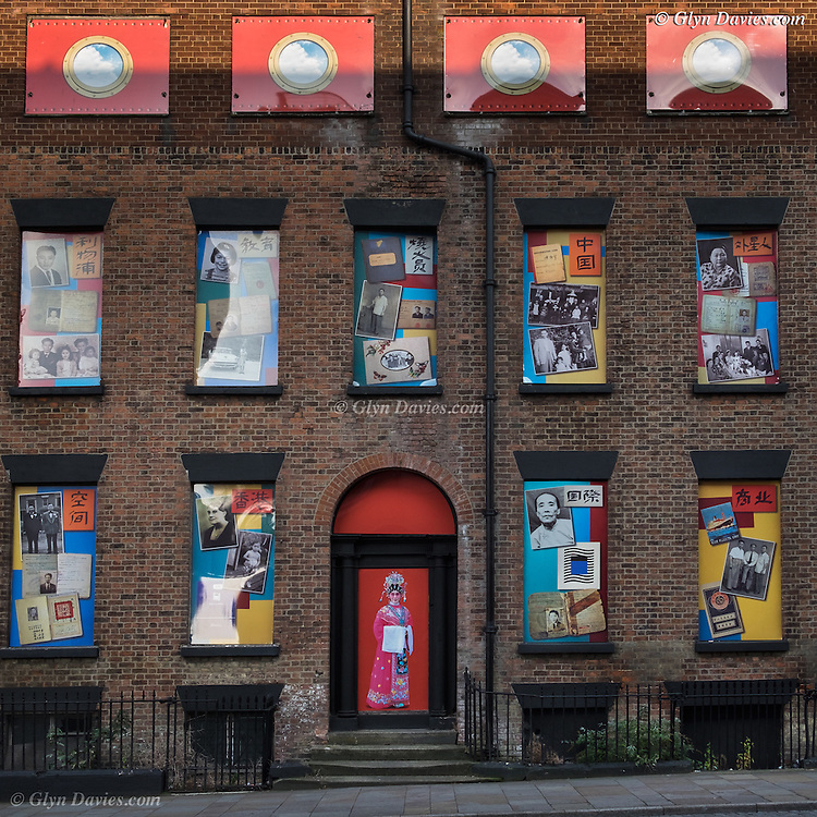 """A row of terraced houses in Duke Street has formed the backdrop to a unique piece of public art reflecting an important part of the city's history.<br /> Giant photographs which tell the story of Chinese sailors and their families have been installed on the houses which are next door to the Wah Sing Chinese School.<br /> The buildings, next to Iliad's development East Village at the top of Duke Street have been derelict for many years but the properties have now been given a new lease of life.<br /> The artwork """" Opera for Chinatown"""" – has been created as part of a year-long project to create a digital archive of oral histories and family photographs of the Chinese community by artists and oral historians John Campbell and Moira Kenny also known as The Sound Agents."""