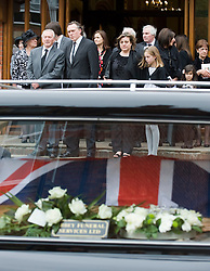 © licensed to London News Pictures. 18/05/2011. Tonbridge, UK. Friends and family watch over The coffin of heavyweight boxing legend Sir Henry Cooper as it leaves Corpus Christi Church in Lyons Crescent, Tonbridge, Kent today (18/05/2011).  Please see special instructions for usage rates. Photo credit should read Ben Cawthra/LNP