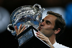 MELBOURNE, Jan. 28, 2018  Switzerland's Roger Federer kisses his trophy during the awarding ceremony of the men's singles final match against Croatia's Marin Cilic at Australian Open 2018 in Melbourne, Australia, Jan. 28, 2018. (Credit Image: © Li Peng/Xinhua via ZUMA Wire)