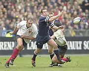 Saint-Denis, Paris, France, 23rd February 2003,  Six Nations Rugby International, France vs Scotland, Stade de France,<br /> [Mandatory Credit: Peter Spurrier/Intersport Images],<br /> Photo Peter Spurrier<br /> 23/02/2003<br /> Sport -SIX NATIONS RUGBY - France v Scotland<br /> Olivier Brouzet left moves in to tackle Brendan Laney as he passes the ball out.