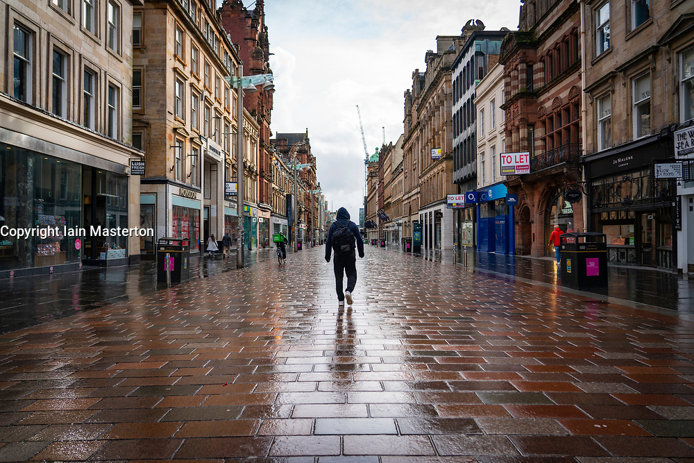 Glasgow, Scotland, UK. 12 March 2021. On the day Covid-19 lockdown is relaxed slightly in Scotland the city centre streets in Glasgow city centre remain almost deserted virtually all shops ad cafes are still closed. Pic; Buchanan Street is almost deserted of people. Iain Masterton/Alamy Live News