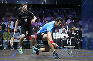 Omar Mosaad of Egypt (wearing light Blue shirt) hits a shot against Mathieu Castagnet of France (wearing Black shirt)the Final, Omar Mosaad of Egypt v Mathieu Castagnet of France , Canary Wharf Squash Classic 2016 , at the East Wintergarden in Canary Wharf , London on Friday 11th March 2016.<br /> pic by John Patrick Fletcher, Andrew Orchard sports photography.