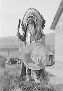 9305-B7327A.  Chief Tommy Thompson at end of long house in Celilo Village. April 16, 1939. Celilo Falls, Oregon