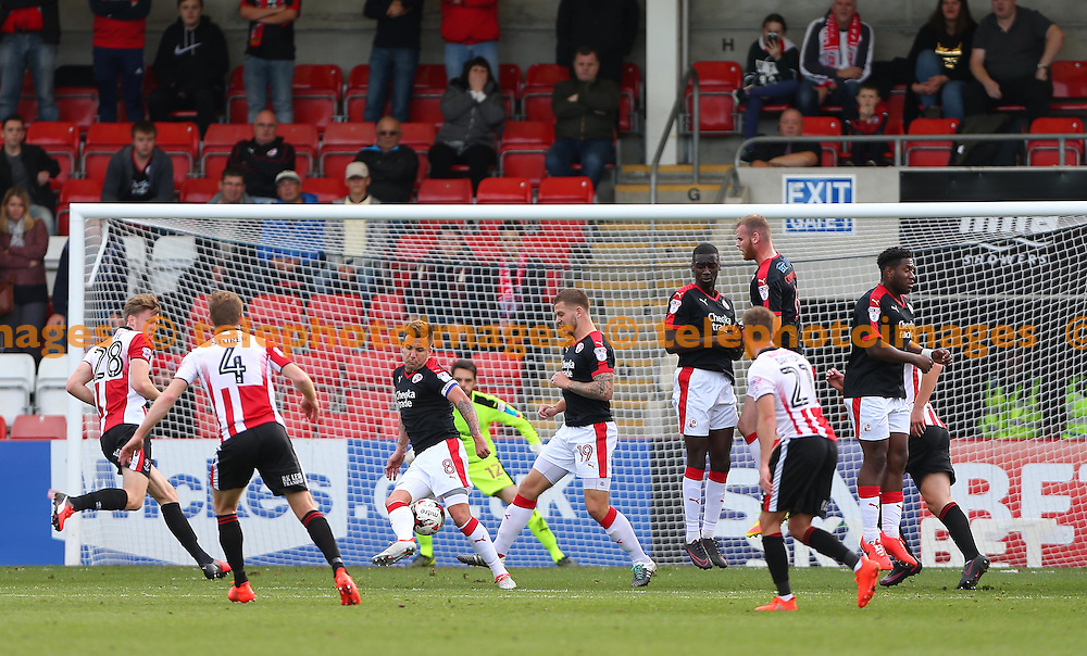 Crawley's Captain Jimmy Smith  blocks a free kick <br /> eduring the Sky Bet League 2 match between Cheltenham Town and Crawley Town at the Abbey Business Stadium in Cheltenham. October 15, 2016.<br /> James Boardman / Telephoto Images<br /> +44 7967 642437