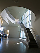 Dramatic architecture and distinctive exhibit galleries make the Museum of the North a must-see destination at the University of Alaska, in Fairbanks, Alaska, USA. Interior stairs wind gracefully to the second floor.
