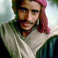 INDIA, Kashmir. Nomadic Gujar shepherd near Pahalgam in Great Himalaya Range.