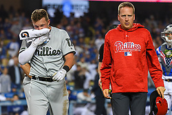 May 28, 2018 - Los Angeles, CA, U.S. - LOS ANGELES, CA - MAY 28: Philadelphia Phillies left fielder Rhys Hoskins (17) walks off the field with a trainer after fouling a pitch off his face during a MLB game between the Philadelphia Phillies and the Los Angeles Dodgers on Memorial Day, May 28, 2018 at Dodger Stadium in Los Angeles, CA. (Photo by Brian Rothmuller/Icon Sportswire) (Credit Image: © Brian Rothmuller/Icon SMI via ZUMA Press)