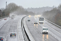 © Licensed to London News Pictures. 11/02/2014. Shepperton and Chertsey, UK Traffic on the M3. Flooding in SHEPPERTON AND CHERTSEY in Surrey today 11th February 2014 after the River Thames burst its banks. The Environment Agency has issued 14 Severe Flood Warnings alone the Thames. Photo credit : Stephen Simpson/LNP