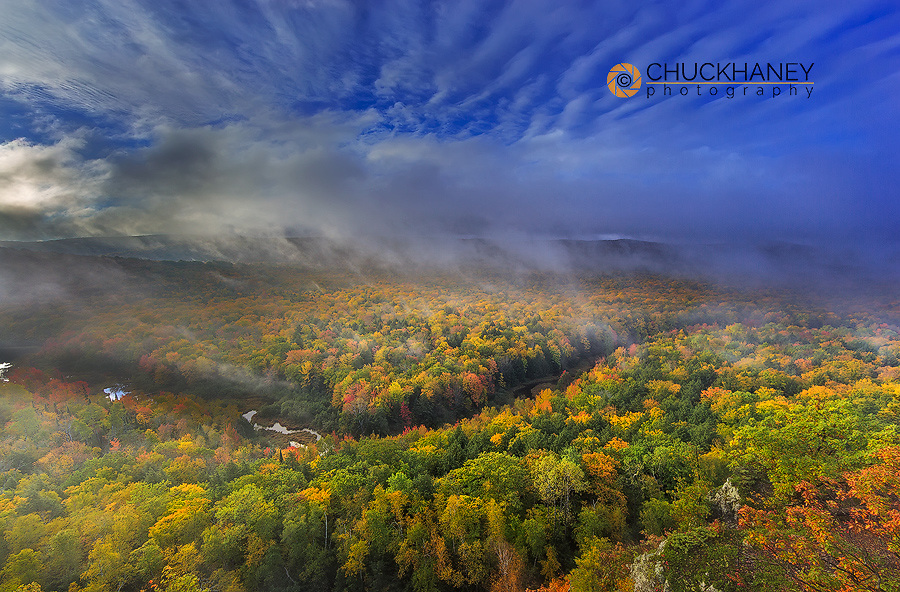 Vivid sunrise over the Big Carp River and Lake of the Clouds in autumn at Porcupine Mountains State Park, Michigan, USA