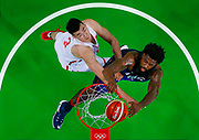 Deandre Jordan (USA) of the USA dunks on Li Muhao (CHN) of China at the 2016 Rio Olympics.   REUTERS/Jim Young