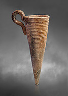 Minoan stone conical rhython with carved ring decoration, Zakros 1500-1400 BC; Heraklion Archaeological  Museum, grey background. .<br /> <br /> If you prefer to buy from our ALAMY PHOTO LIBRARY  Collection visit : https://www.alamy.com/portfolio/paul-williams-funkystock/minoan-art-artefacts.html . Type -   Heraklion   - into the LOWER SEARCH WITHIN GALLERY box. Refine search by adding background colour, place, museum etc<br /> <br /> Visit our MINOAN ART PHOTO COLLECTIONS for more photos to download  as wall art prints https://funkystock.photoshelter.com/gallery-collection/Ancient-Minoans-Art-Artefacts-Antiquities-Historic-Places-Pictures-Images-of/C0000ricT2SU_M9w