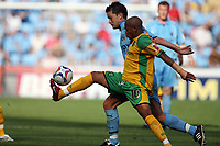 Photo: Rich Eaton.<br /> <br /> Coventry City v Norwich City. Coca Cola Championship. 09/09/2006. Robert Huges of Coventry left tries to tackle Rob Earnshaw of Norwich right