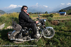 Rip Rolfsen poses with a spectacular background of 23,000' peaks on day-4 our our Himalayan Heroes adventure riding from Pokhara to Kalopani, Nepal. Friday, November 9, 2018. Photography ©2018 Michael Lichter.