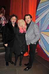 Left to right, TIM BURTON, JANE GOLDMAN and JONATHAN ROSS at A Night of Funk & Soul in aid of Save The Children held at The Roundhouse, Camden, London on 20th March 2013.