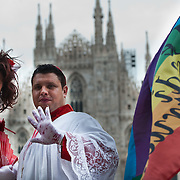 MILAN, ITALY - JUNE 12:  Two participants to the Gay Pride Milano dressed as a cardinal and as a bride in front of Milan Il Duomo cathedral on June 12, 2010 in Milan, Italy.  Pride Milano is one of the oldest gay marches in Italy and today's march is against homophobic violence  (Photo by Marco Secchi/Getty Images)
