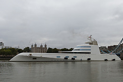© Licensed to London News Pictures. 10/09/2016. LONDON, UK.  Motor Yacht A leaves London passing the Tower of London before going under Tower Bridge on the River Thames early this morning. The £225m superyacht, owned by Russian billionaire, Andrey Melnichenko (known as the King of Bling) has spent the last week moored next to HMS Belfast during a London visit. Motor Yacht A is 390ft long, was designed by Philippe Starck, inspired by a submarine and is now reported to be up for sale because Melnichenko is building a new superyacht.  Photo credit: Vickie Flores/LNP