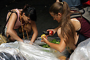 Stephanie, 21, (left) and another member of the Freegan community in New York, recovering edible food from dump sites along 3rd Avenue in Manhattan, New York, NY., on Wednesday, July 19, 2006. Freegans are a community of people who aims at recovering wasted food, books, clothing, office supplies and other items from the refuse of retail stores, frequently discarded in brand new condition. They recover goods not for profit, but to serve their own immediate needs and to share freely with others. According to a study by a USDA-commissioned study by Dr. Timothy Jones at the University of Arizona, half of all food in the United States is wasted at a cost of $100 billion dollars every year. Yet 4.4 million people in the United States alone are classified by the USDA as hungry. Global estimates place the annual rate of starvation deaths at well over 8 million. The massive waste generated in the process fills landfills and consumes land as new landfills are built. This waste stream also pollutes the environment, damages public health as landfills chemicals leak into the ground, and incinerators spew heavy metals back into the atmosphere. Freegans practice strategies for everyday living based on sharing resources, minimizing the detrimental impact of our consumption, and reducing and recovering waste and independence from the profit-driven economy. They are dismayed by the social and ecological costs of an economic model where only profit is valued, at the expense of the environment. In a society that worships competition and self-interest, Freegans advocate living ethical, free, and happy lives centred around community and the notion that a healthy society must function on interdependence. Freegans also believe that people have a right and responsibility to take back control of their time.