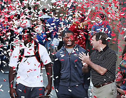 December 27, 2017 - Anaheim, CA, USA - Confetti flys over Georgia players, from left, Roquan Smith, Nick Chubb and head coach Kirby Smart during a news conference at Disney California Adventure Park for the Rose Bowl, on Wednesday, Dec. 27, 2017, in Anaheim, Calif. (Credit Image: © Curtis Compton/TNS via ZUMA Wire)