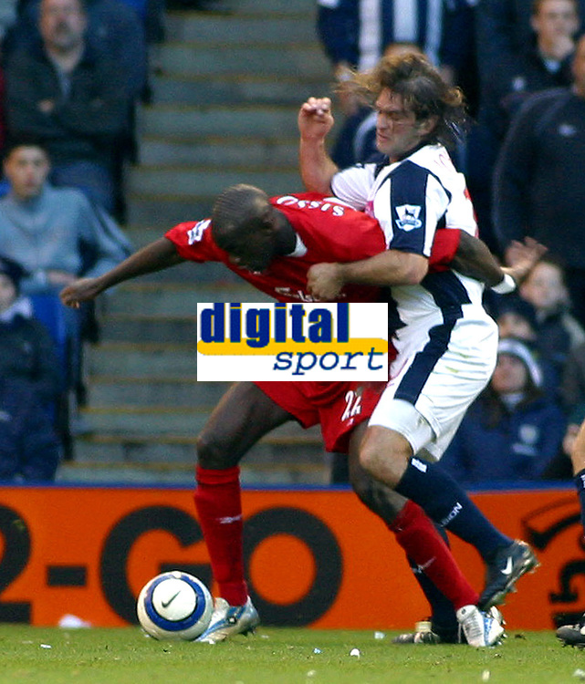 Photo: Dave Linney.<br />West Bromwich Albion v Liverpool. The Barclays Premiership. 01/04/2006.Liverpool'sMomo Sissoko(L) keeps  Andy Johnson at bay
