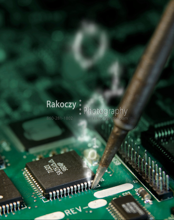A macro view of a soldering iron tip touching an integrated circuit chip on a board, with smoke in the shape of one's and zero;s emanating from the tip of the iron.