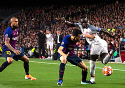 BARCELONA, May 2, 2019  FC Barcelona's Sergio Busquets (C) competes with Liverpool's Sadio Mane (R) during the UEFA Champions League semifinal first leg soccer match between FC Barcelona and Liverpool in Barcelona, Spain, on May 1, 2019. Barcelona won 3-0. (Credit Image: © Joan Gosa/Xinhua via ZUMA Wire)
