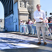 William Russell is a Lord Mayor of the City of London attend to celebrates London hosting of UEFA EURO 2020 including both semi finals and the final with thousands of poster laid along Tower Bridge on 13th June 2021, London, UK