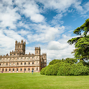 Highclere Castle in Hampshire, UK. Highclere Castle, in Hampshire, is the home of the Earl and Countess of Carnarvon and is used in the filming of the British TV series Downton Abbey.