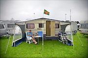 Nederland, Nijmegen, 15-7-2015De voorbereidingen voor de komende vierdaagse en bijhorende zomerfeesten zijn in volle gang. Op de Waalkade en het Valkhof wodt gewerkt aan de podia en  de vierdaagsecamping op de sportvelden van SC Hatert loopt langzaam maar zeker vol. Het vierdaagsevlaggetje wappert fier in de wind op een van de luifels van een campinggast.Zaterdag gaan de zomerfeesten in de stad van start en vanaf dinsdag de lopers aan de vierdaagse. The International Four Day Marches Nijmegen, or Vierdaagse, is the largest marching event in the world. It is organized every year in Nijmegen mid-July as a means of promoting sport and exercise. Participants walk 30, 40 or 50 kilometers daily, and on completion, receive a royally approved medal, Vierdaagsekruisje. The participants are mostly civilians, but there are also a few thousand military participants. The maximum number of 45,000 registrations has been reached. More than a hundred countries have been represented in the Marches over the years.  Foto: Flip Franssen/Hollandse Hoogte