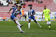 Conor McAleny of Wigan Athletic shoots wide of goal. Skybet football league one match , Wigan Athletic v Southend Utd at the DW Stadium in Wigan, Lancs on Saturday 23rd April 2016.<br /> pic by Chris Stading, Andrew Orchard sports photography.
