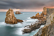 Sunrise over a coast with cliffs and rock towers, Cantabria, Spain<br /> <br /> Morning red over a coast with cliffs and rock towers, Cantabria, Spain